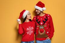 Young Couple In Christmas Swea...