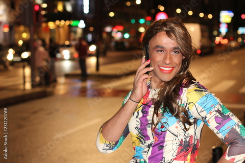 Fotomural African American transgender woman calling by phone outdoors