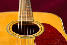 Rich Color Solid Spruce Top Acoustic Guitar Detail. Selective Focus On Strings.