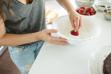 Woman Dipping Strawberries Int...