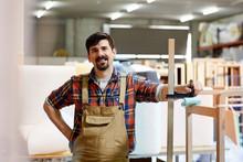 Smiling Worker Standing In Sofa Workshop