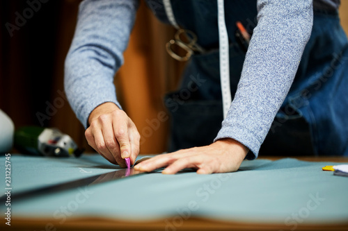 Spoed Foto op Canvas Stof Midsection Of Worker Marking On Fabric At Sofa Workshop