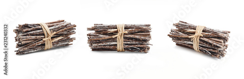 Photo Side view of dry twigs tied in a bundle with natural twine isolated on a white background
