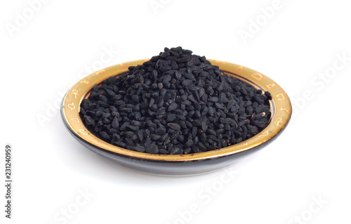 In de dag Kruiderij Seed of Nigella sativa or fennel flower, nutmeg flower, black caraway, Roman coriander, black cumin, blackseed, black caraway, Bunium persicum. Isolated
