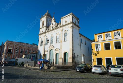 Fotografia  Bright scenic view of classic colonial Portuguese church architecture in a plaza