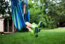 Young Child Swinging In A Hammock Swing