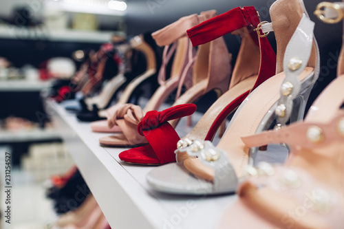 High heeled shoes displayed on showcase of a store. Shopping and sales concept