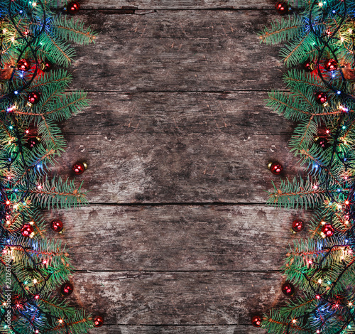 Christmas Fir Branches With Lights And Red Decorations On Wooden Background Xmas Hy New