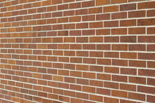 Grungy Vintage Brown Brick Wall Abstract Background (angle View)