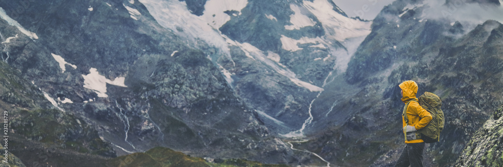 Fototapety, obrazy: Mountain hike Europe travel hiker woman trekking in Switzerland Alps mountains landscape background. Panoramic banner of hiker on adventure trek.