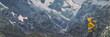Leinwanddruck Bild - Mountain hike Europe travel hiker woman trekking in Switzerland Alps mountains landscape background. Panoramic banner of hiker on adventure trek.
