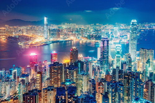 Scenic view on Hong Kong, China, by night. Multicolored nighttime skyline with illuminated skyscrapers seen from Victoria Peak
