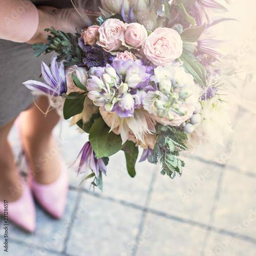 Fotobehang Bloemen Beautiful bouquet with delicate flowers. Pink-white-purple bouquet. Bridal bouquet in female hands