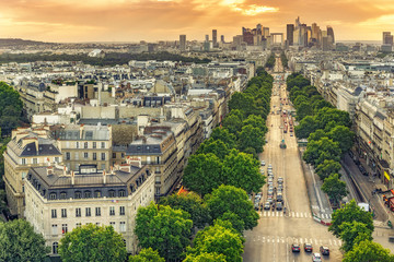 Scenic rooftop view of Paris, France, from the Triumphal Arc with La Defence in the background.