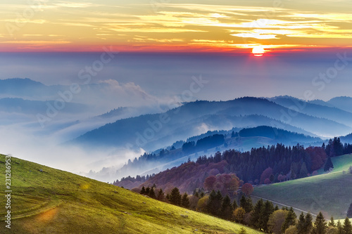 Cadres-photo bureau Automne Dramatic sunset over rolling hills of the Black forest in Germany. Scenic travel background.