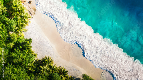 Foto Tropical beach with sea and palm taken from drone