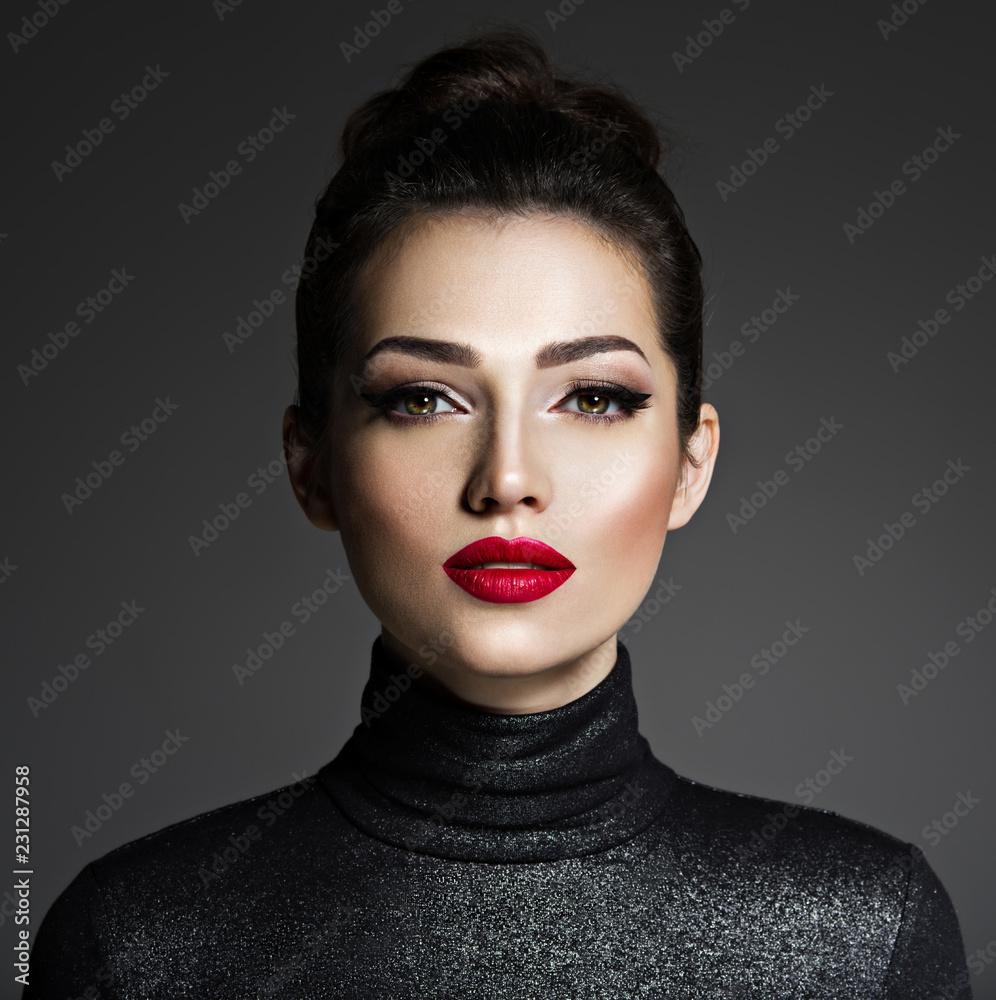 Fototapeta Beautiful young fashion woman with red lipstick.
