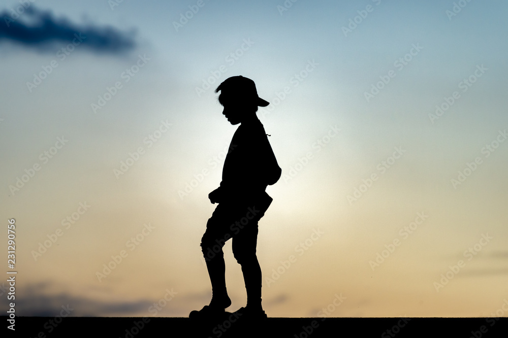Fototapety, obrazy: Silhouette of a kid at sunset