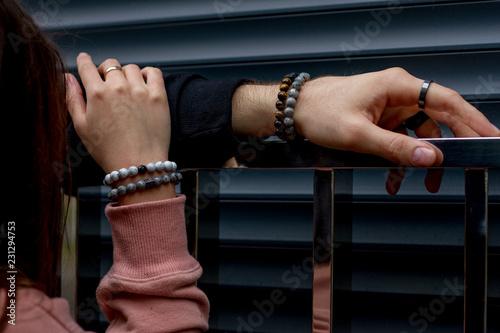 Fototapeta Men's bracelets on hand