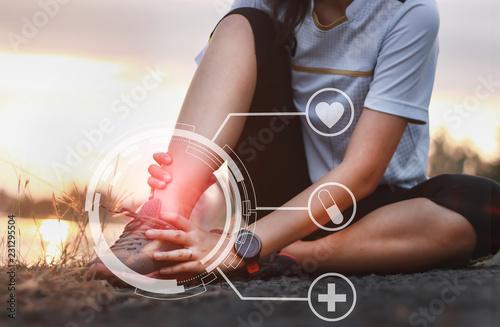 Ankle twist sprain accident in sport exercise running jogging Fototapeta