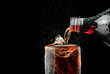 canvas print picture - Pour soft drink in glass with ice splash on dark background.
