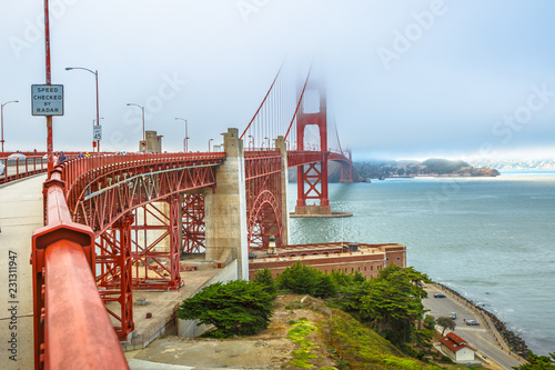Staande foto Amerikaanse Plekken Fort Point view of Golden Gate Bridge south shore, symbol landmark of San Francisco, California, United States. Typical fog in summertime. Travel and holidays concept.