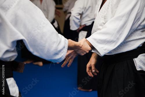 Photo Aikidoki are fighting in aikido training