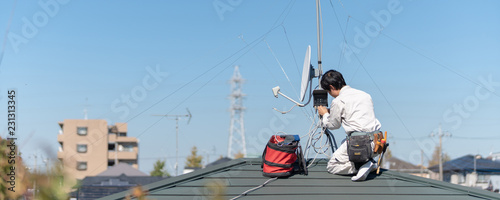 Antenna installation works at a rooftop. Canvas Print