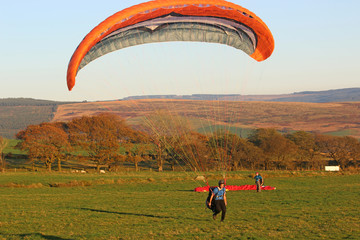 Fototapeta Paraglider landing