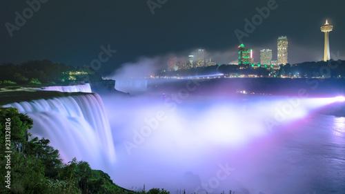 Wall Murals Waterfalls Niagara Falls lit at night by colorful lights. Niagara Falls, NY, USA.