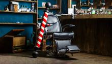 Barber Shop Pole. Logo Of The Barbershop, Symbol. Stylish Vintage Barber Chair. Hairstylist In Barbershop Interior. Barber Shop Chair. Barbershop Armchair, Hairdresser, Hair Salon, Barber Shop For Men