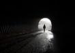 canvas print picture - Licht am Ende vom Tunnel, Silhouette geht durch die Dunkelheit