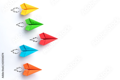 Obraz Paper planes on white background. Business competition concept. - fototapety do salonu