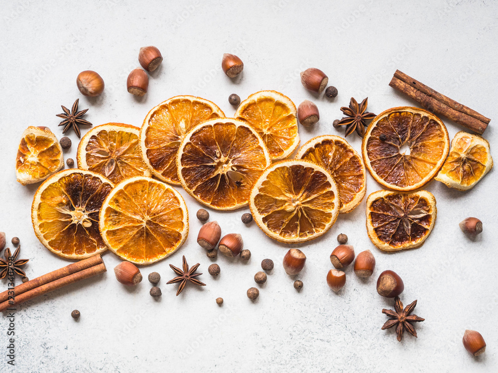 Fototapety, obrazy: Bright Christmas or New Year background - dry orange slices and spices. Ingredients for making winter seasonal drink - mulled wine. Top view