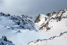 Cold Snowy Mountain Peaks In Winter