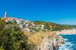 Adriatic town of Vrbnik on Island of Krk in Croatia, panoramic view, houses on rock above the sea