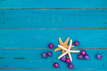 Blank Rustic Teal Blue Wood Holiday Sign With Starfish And Pink And Turquoise Christmas Ornaments