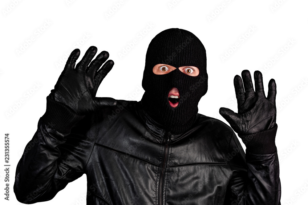 Fototapeta Arrested masked thief with raised arms isolated on white background