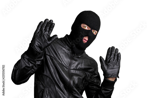 Cuadros en Lienzo Arrested masked thief with raised arms isolated on white background