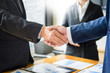 Close up of a business handshake, finishing up a meeting acquisition Greeting Deal concept.