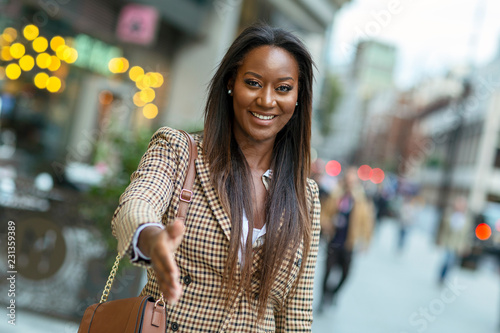 Valokuva  young business woman offering a handshake