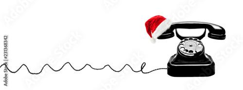 Obraz Telefon mit Weihnachtsmütze - fototapety do salonu