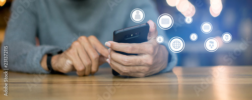 Obraz close up businessman hand touching on smartphone screen with networking connect effect for technology concept - fototapety do salonu