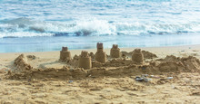 Sand Castle On The Beach Near The Surf Line