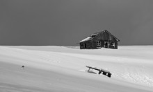 Black And White Picture Of An Abandoned Shepherd Cottage In The Mountains During Winter With Snow