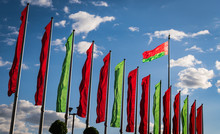 Flag Of Belarus Against The Sky With Clouds