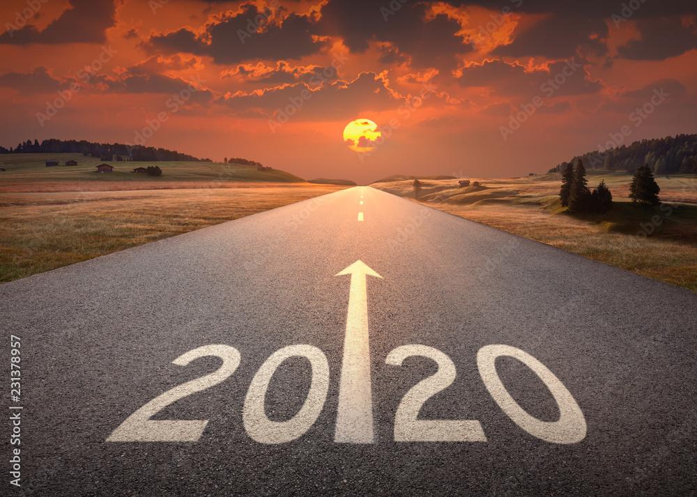 Fototapeta 2020 new year at beautiful empty highway at sunset