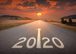 canvas print picture - 2020 new year at beautiful empty highway at sunset