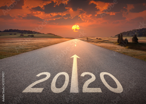 Fototapeta 2020 new year at beautiful empty highway at sunset obraz