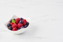 Fresh Blueberries And Raspberr...